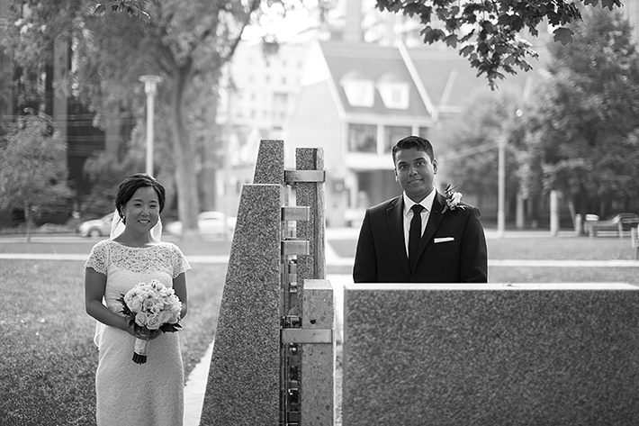 a photo of the couple standing side by side at a wedding in toronto