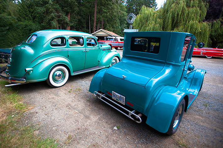 a travel photo of blue cars at the antique car show at saanich museum in sidney british columbia