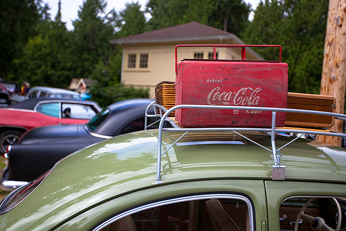 a travel photo of a coke suitcase at the antique car show at saanich museum in sidney british columbia