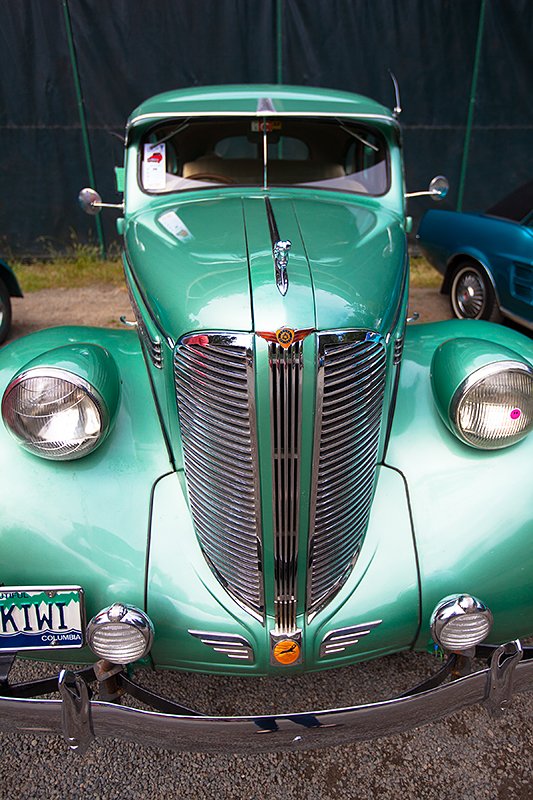 a travel photo of a teal car at the antique car show at saanich museum in sidney british columbia