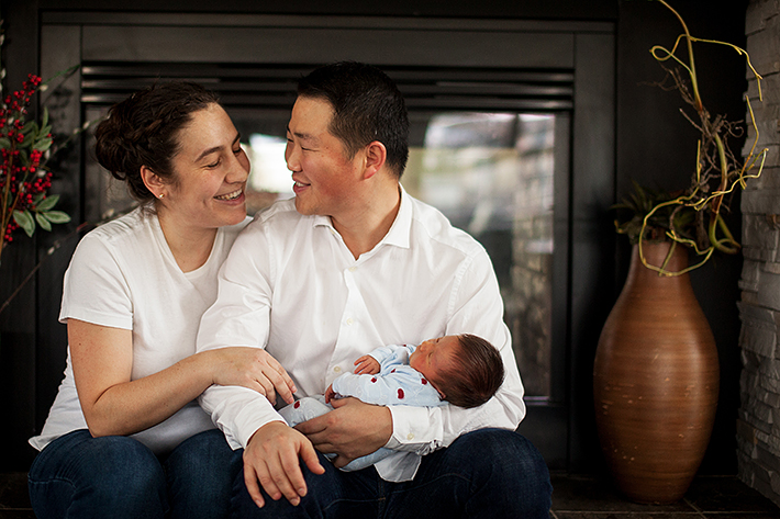 a new born photo being held by his parents in port moody, bc