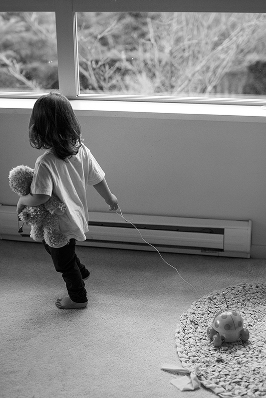 a family photo of a daughter playing in port moody, bc
