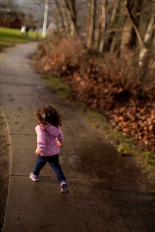 a family photo of a daughter running in port moody, bc