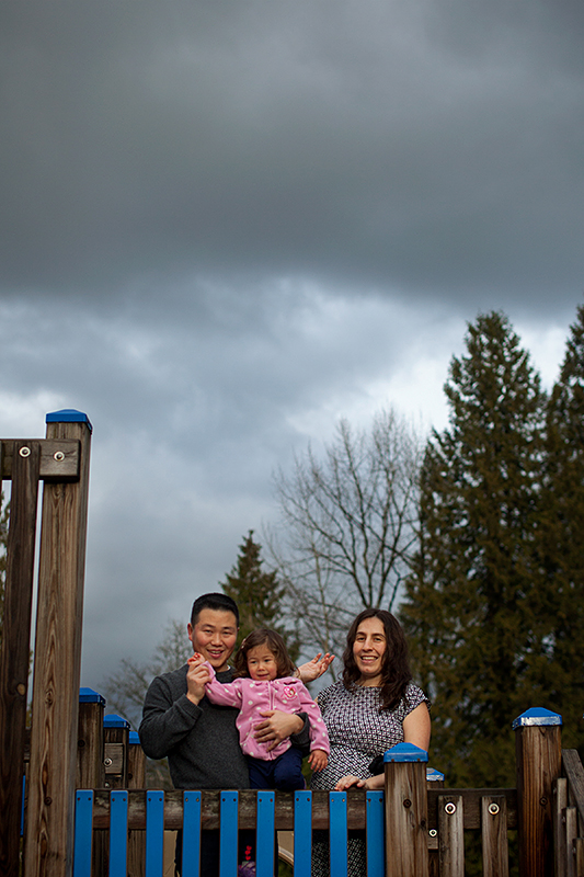 a family portrait on a play ground structure in port moody, bc