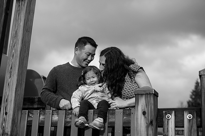a happy family portrait on a play ground structure in port moody, bc