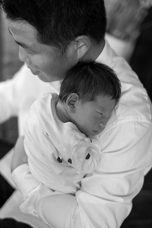 a new born photo being held by his dad in port moody, bc