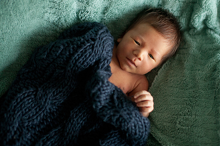 a new born photo snuggled in a blanket in port moody, bc