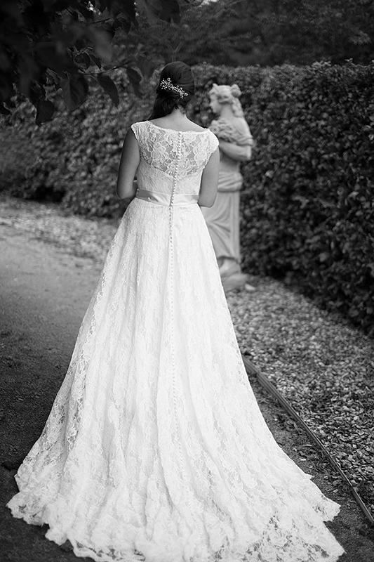 a photo of a bride's wedding dress at the arboretum in guelph ontario