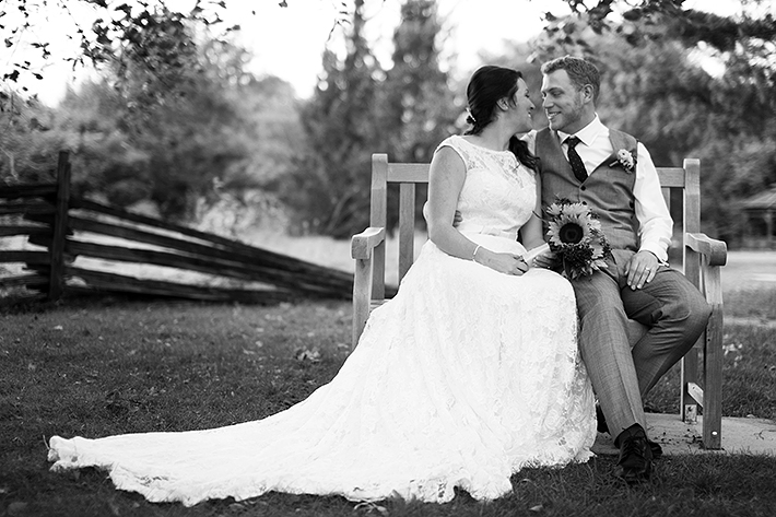 a wedding photo of the couple snuggling at the arboretum in guelph ontario