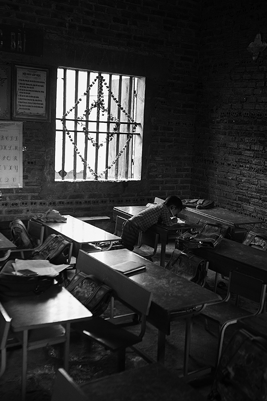 a travel photo from northern vietnam plan canada a boy studying at school