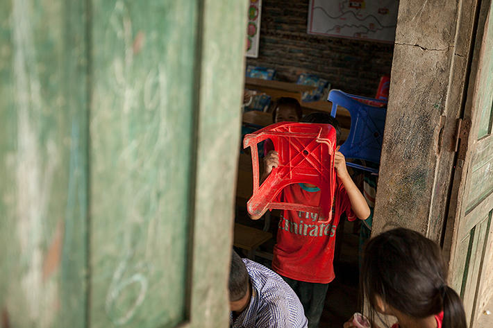 a travel photo from northern vietnam plan canada boys playing hide and go seek at school