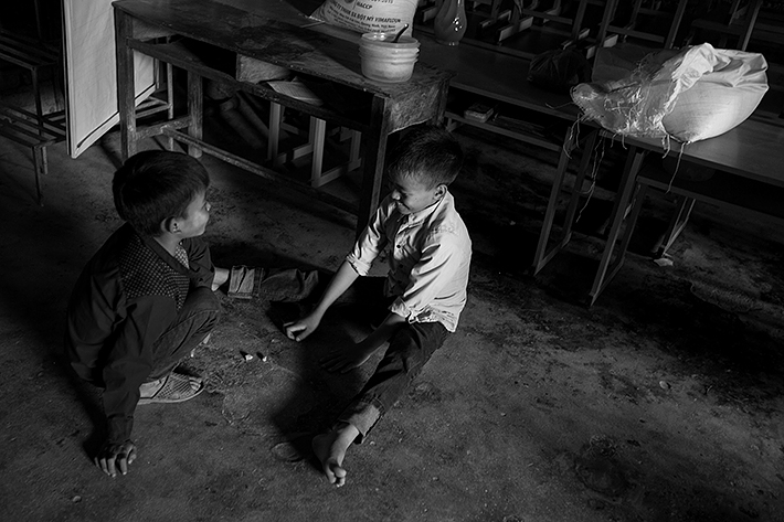 a travel photo from northern vietnam plan canada boys playing in the kitchen at school
