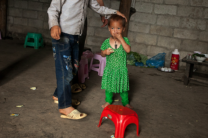 a travel photo from northern vietnam plan canada foster family showing brotherly love for his sister at home