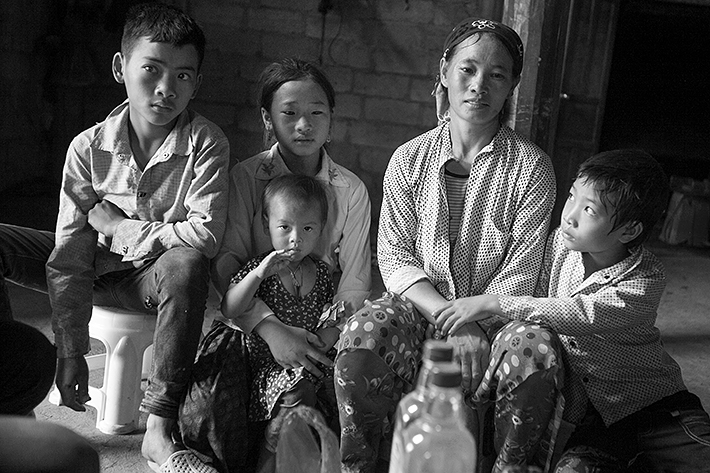 a travel photo from northern vietnam plan canada foster family getting gifts at home