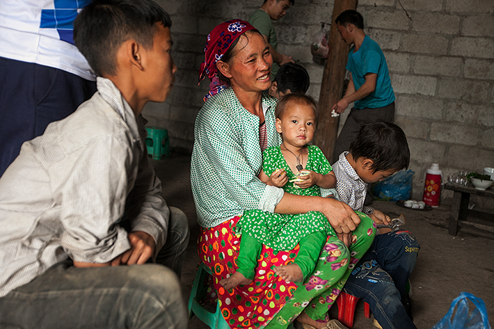 a travel photo from northern vietnam plan canada foster family mother sitting with her daughter at home
