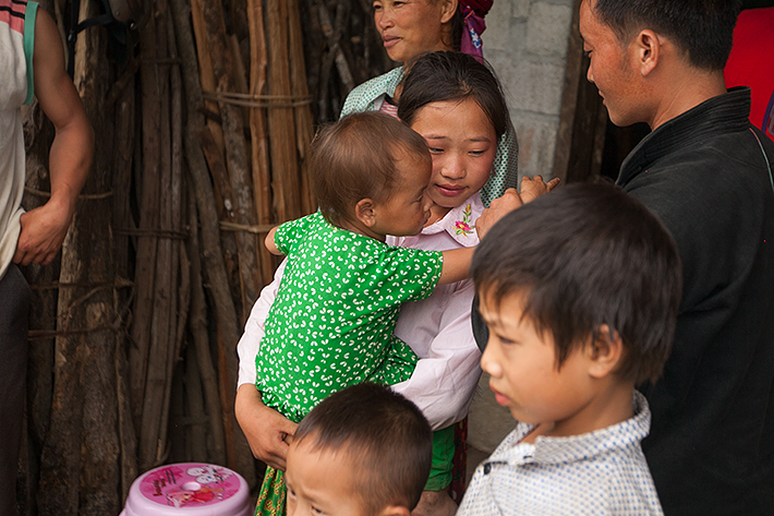 a travel photo from northern vietnam plan canada foster family outside home