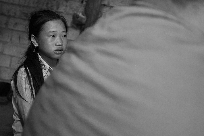 a travel photo from northern vietnam plan canada foster girl inside her family's home