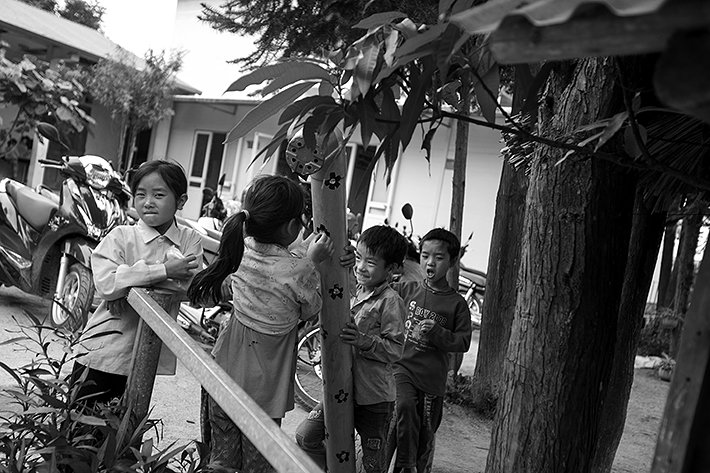 a travel photo from northern vietnam plan canada girls playing at school