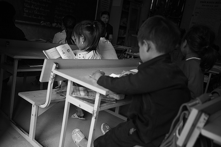 a travel photo from northern vietnam plan canada kids reading at school