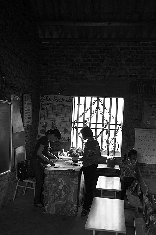 a travel photo from northern vietnam plan canada teachers talking at school
