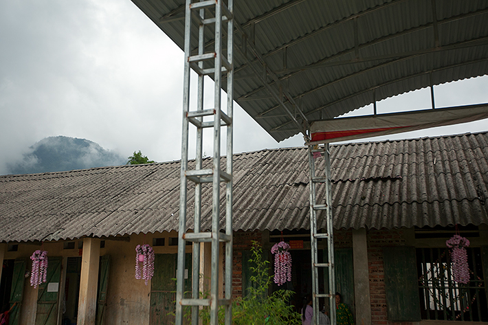 a travel photo from northern vietnam plan canada school house with mountains