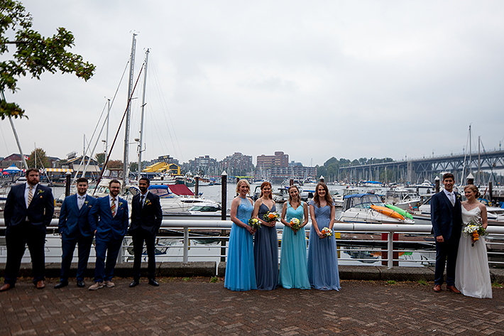a summer wedding party photo at the false creek yacht club on granville island vancouver british columbia