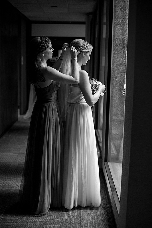 a summer wedding photo of the bride getting ready at the museum of vancouver british columbia