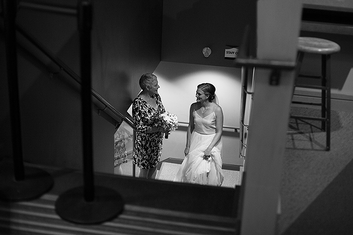 a summer wedding photo of the bride waiting with her mother at the museum of vancouver british columbia