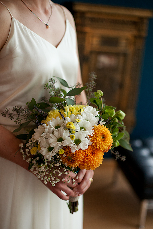 a summer wedding photo of the bride's bouquet at the museum of vancouver british columbia