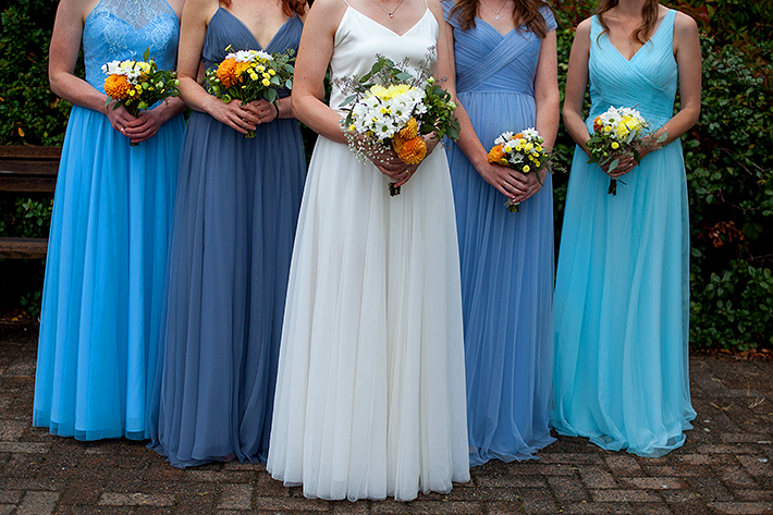 a summer wedding photo of the bridesmaids flowers at the false creek yacht club on granville island vancouver british columbia