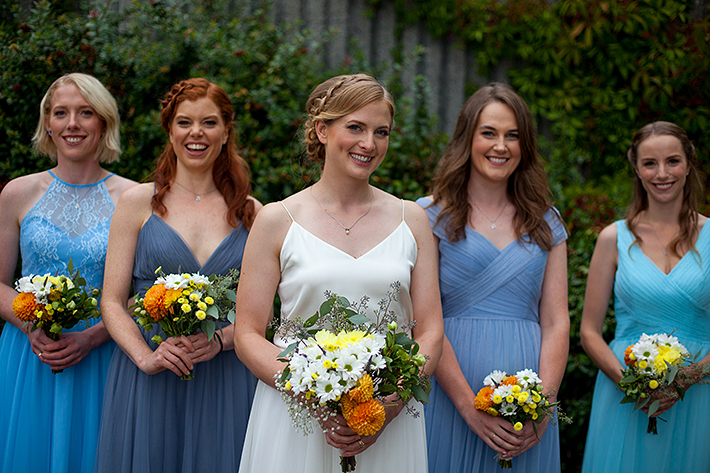 a summer wedding photo of the bridesmaids at the false creek yacht club on granville island vancouver british columbia
