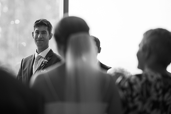 a summer wedding photo of the ceremony first look at the museum of vancouver british columbia