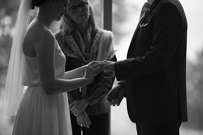 a summer wedding photo of the ceremony ring exchange at the museum of vancouver british columbia