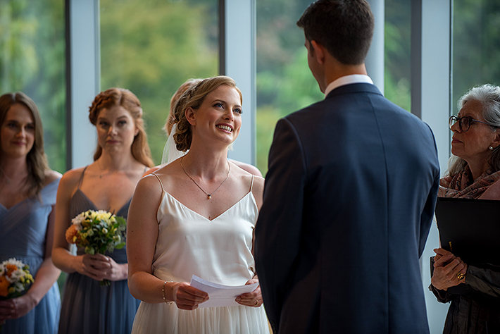 a summer wedding photo of the ceremony vow exchange at the museum of vancouver british columbia