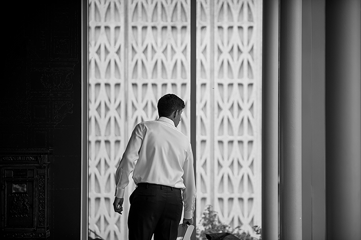 a summer wedding photo of the groom getting ready at the museum of vancouver british columbia