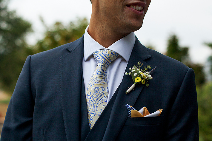 a summer wedding photo of the groom's details at the museum of vancouver british columbia