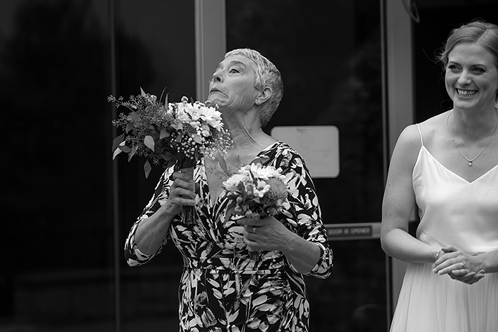 a summer wedding photo of the bride laughing at the museum of vancouver british columbia