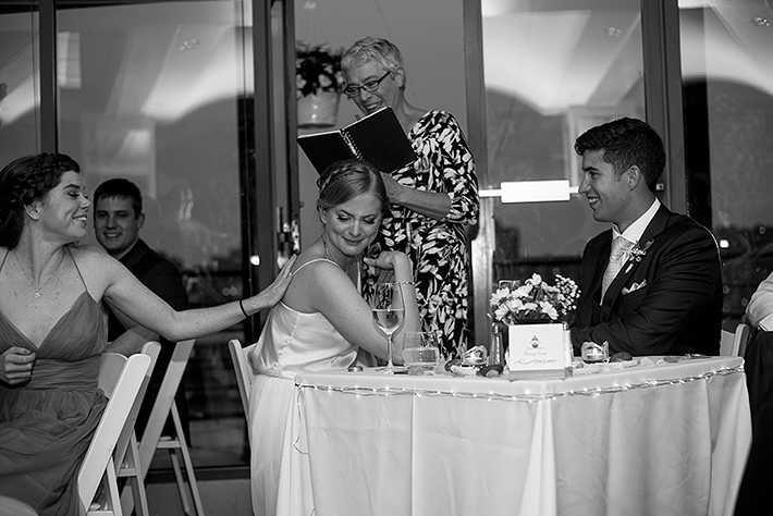 a summer wedding photo of reception speeches at the false creek yacht club on granville island vancouver british columbia