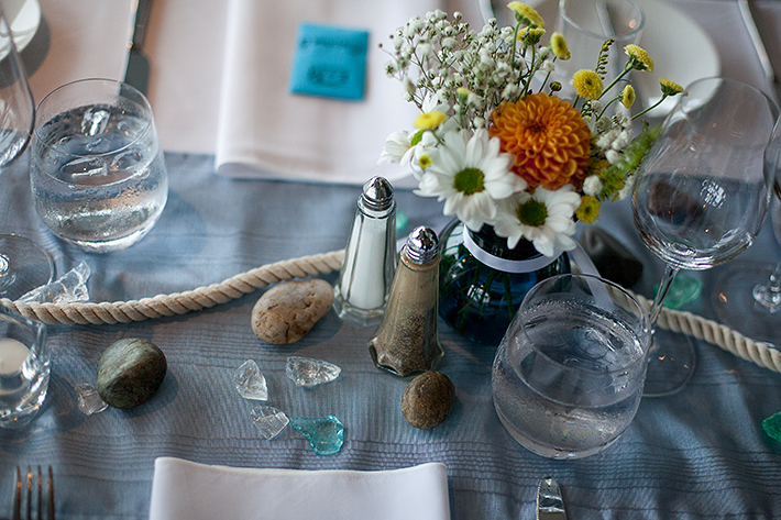 a summer wedding photo of the table details at the false creek yacht club on granville island vancouver british columbia