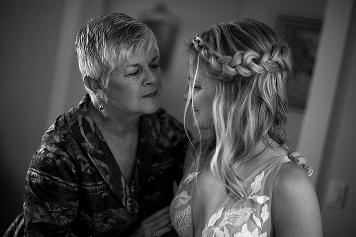 a summer wedding of the bride hugging her mother in vancouver british columbia