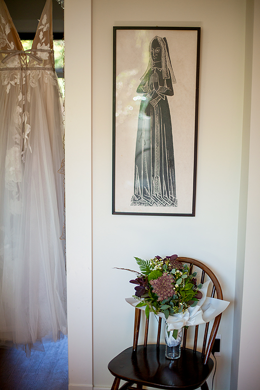 a summer wedding a bridal bouquet and dress hanging in vancouver british columbia