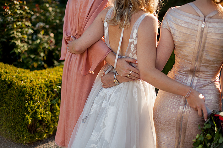 a summer wedding photo of bridesmaids details in the rose garden at vandusen gardens in vancouver british columbia