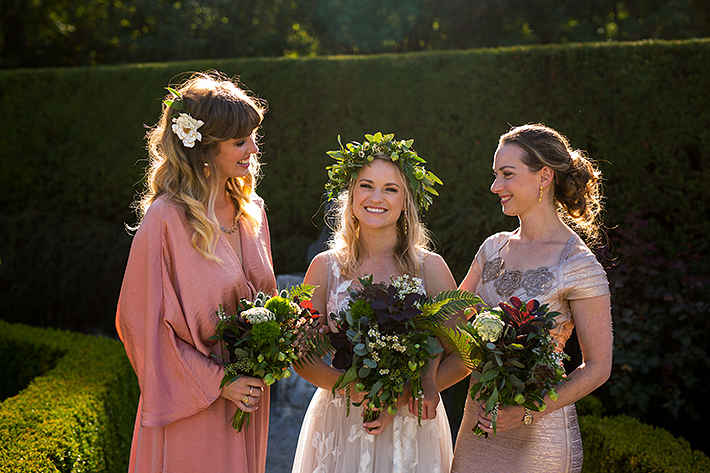 a summer wedding photo of bridesmaids in the rose garden at vandusen gardens in vancouver british columbia