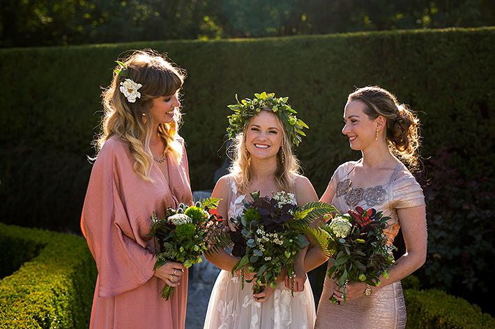 a summer wedding photo of bridesmaids in the rose garden at vandusen gardens in vancouver british columbia