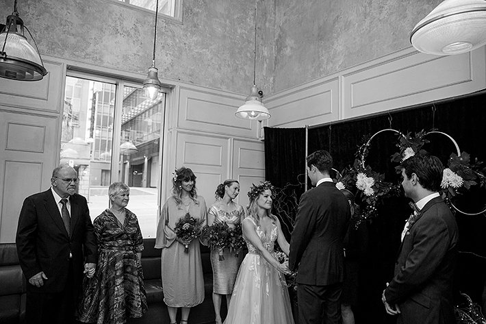 a summer wedding photo of the ceremony vows at medina cafe vancouver british columbia