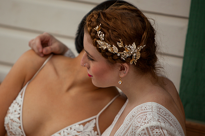 a photo of the couple cuddling hair piece at a same sex styled wedding in Squamish, bc