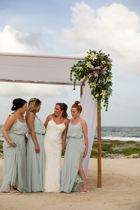 a photo of the bridesmaids at a destination wedding in cancun mexico