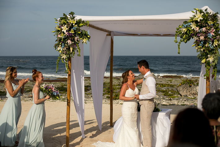a photo of the happy couple at the ceremony at a destination wedding in cancun mexico