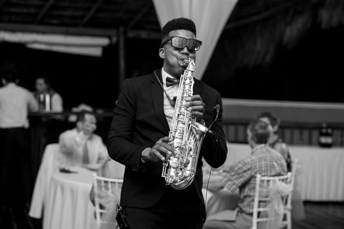 a photo of the saxophone player at a destination wedding in cancun mexico
