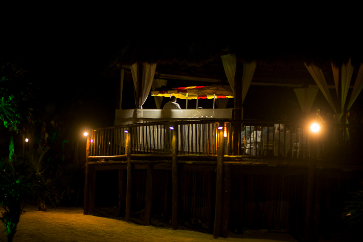 a photo of the venue at night at a destination wedding in cancun mexico